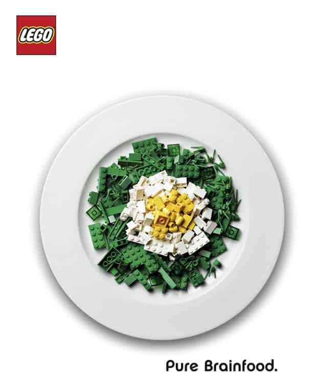 "Targeted marketing ad aimed at parents. It's an image of a plate of LEGOs that look like a salad and labeled, ""Brainfood."""