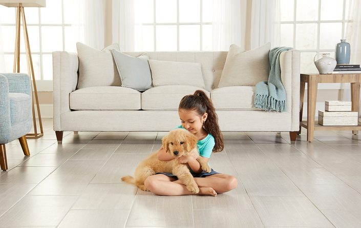 girl on heated floor with puppy