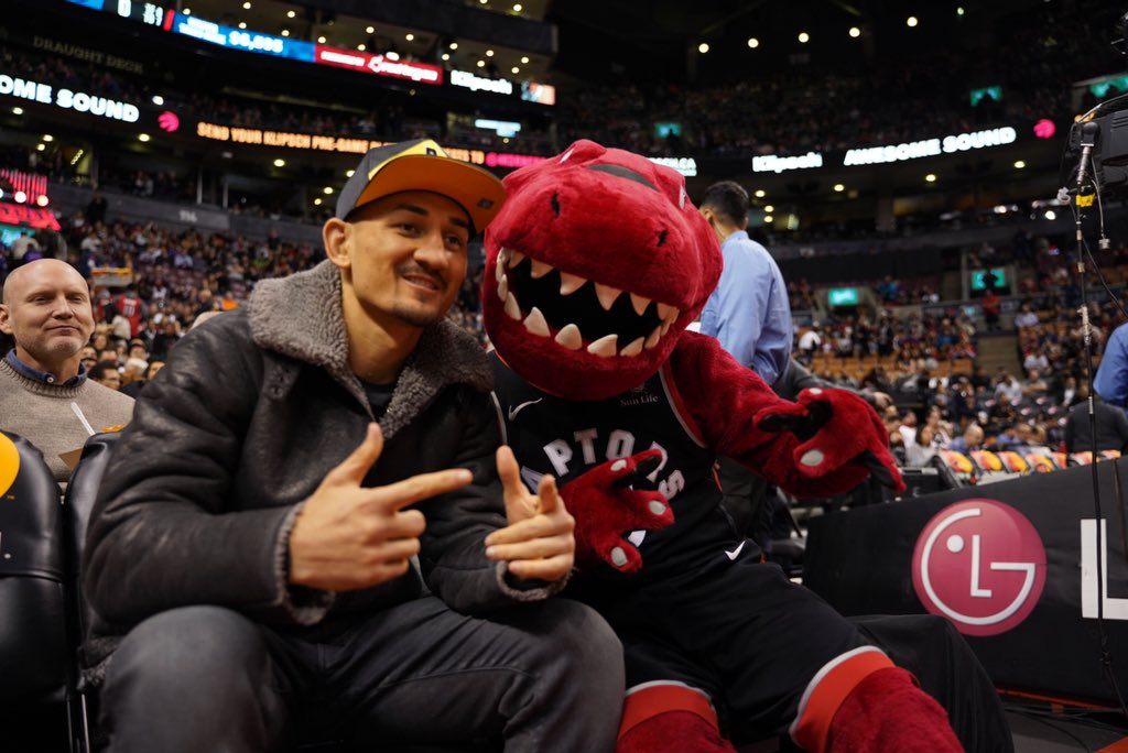 UFC featherweight champ Max Holloway congratulates the NBA champion Toronto Raptors