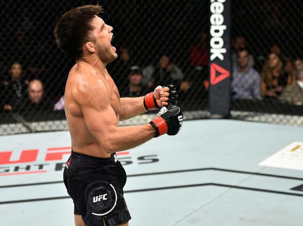 UFC: In an emotional moment, new UFC flyweight champion Henry Cejudo presented his belt to coach Captain Eric Albarracin - Henry Cejudo