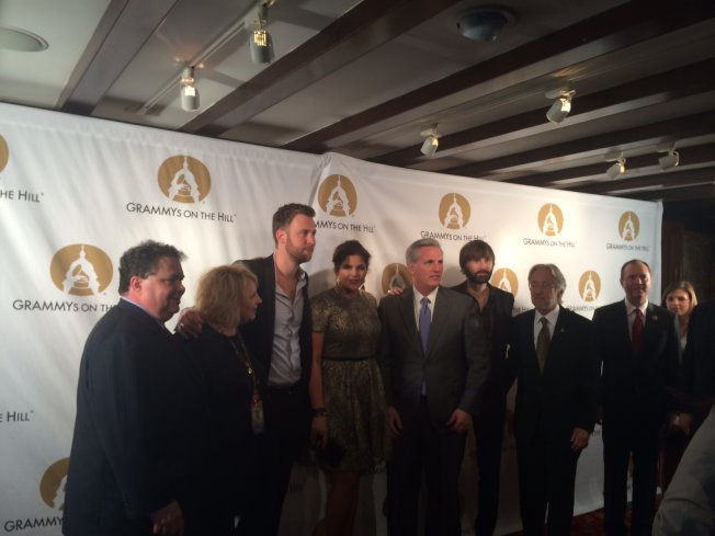 Charlie Kelley, Hillary Scott and Dave Haywood of the band Lady Antebellum, Recording Academy President and CEO Neil Portnow and other members of the Music Industry pose with House Majority Whip Kevin McCarthy at the 2014 Grammys on the Hill event on Wednesday in Washington, D.C.