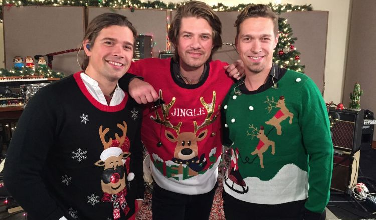 Hanson wearing Christmas sweaters