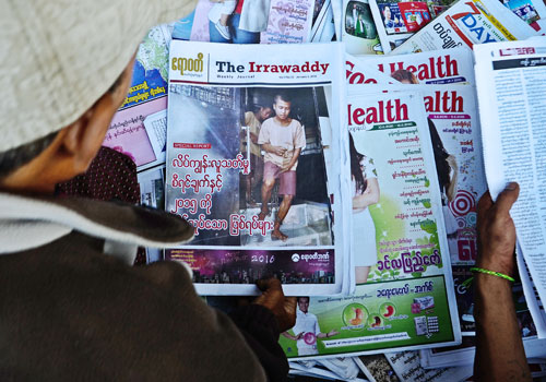 The Irrawaddy's Myanmar edition is sold by an outdoor vendor in Yangon yesterday. Photo: Aung Htay Hlaing / The Myanmar Times