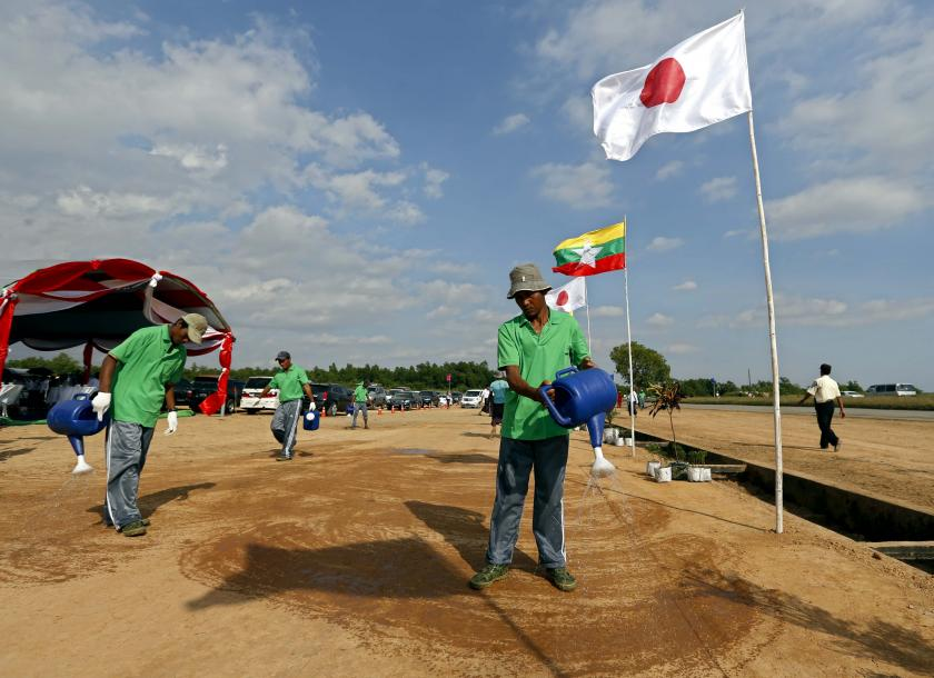 Workers work during the opening of the Thilawa Special Economic Zone in Thilawa in 2013. Photo: EPA