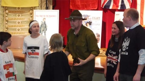 Arn Kind talking to kids in uniform