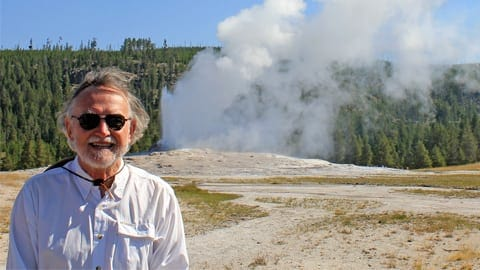 Man in front of hot spring