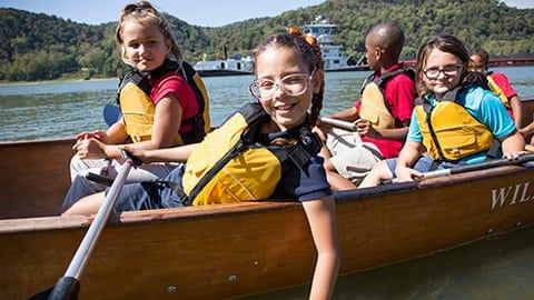 kids in a canoe on a lake