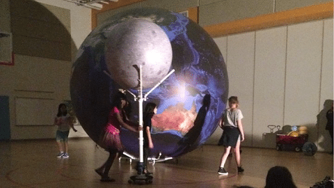 inflatable Earth model and scale-sized moon