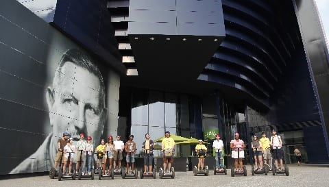 Segway riders admire the Guthrie Theater in Minneapolis.