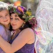 Fairy hugging child