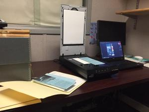 Set up and ready to scan material at the WCS Archives