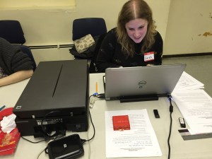 Sarah uses the V800 scanner at the Forest Hills Library.
