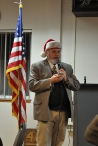 """Santa"" Rich Wersinger recites ""Twas the Night Before Christmas"" at chapter Christmas Scholarship Social"