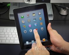 ipad-mini-finger-tap-on-screen