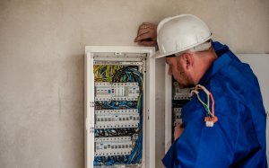 An electrician checking electric box