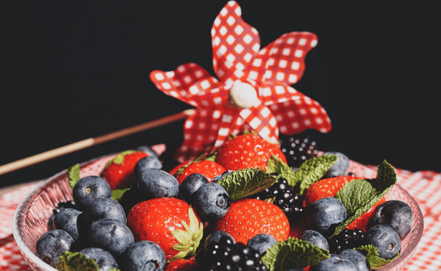 Red and white pinwheel flag with a plate of berries