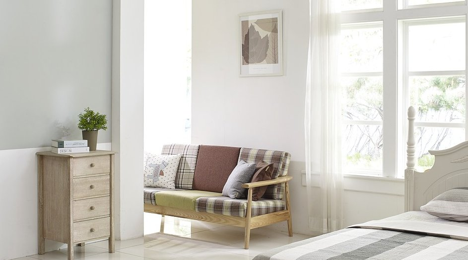 A bedroom with a couch