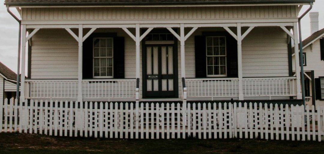 White house with deck and fence