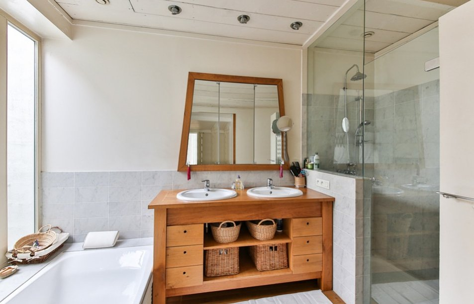 Wooden counter and mirror frame in bathroom