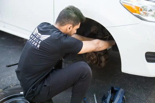 Mobile Motors Mechanic Working On a customer car.