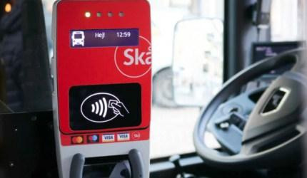 Validator on board Skånetrafiken bus for contactless open-loop payments.