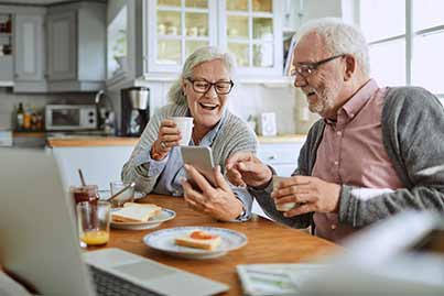 older couple enjoying breakfast in their home