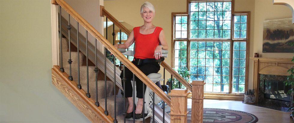 bruno-elite-stair-lift-straight-woman-on-stairs-hero-1600x673