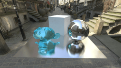 Blender scene with HDR panoramic panoramic lighting. There is a Suzanne monkey head model with a blue glass material, a diffuse box, glossy sphere, and glossy ground plane with higher roughness