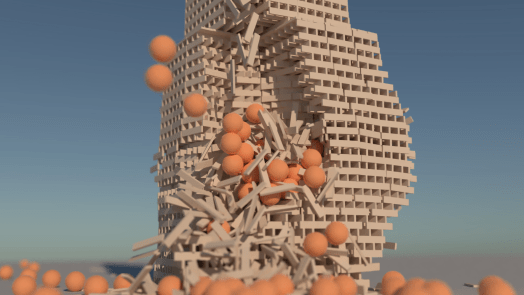 A tower made of KEVA planks being knocked over with orange balls.