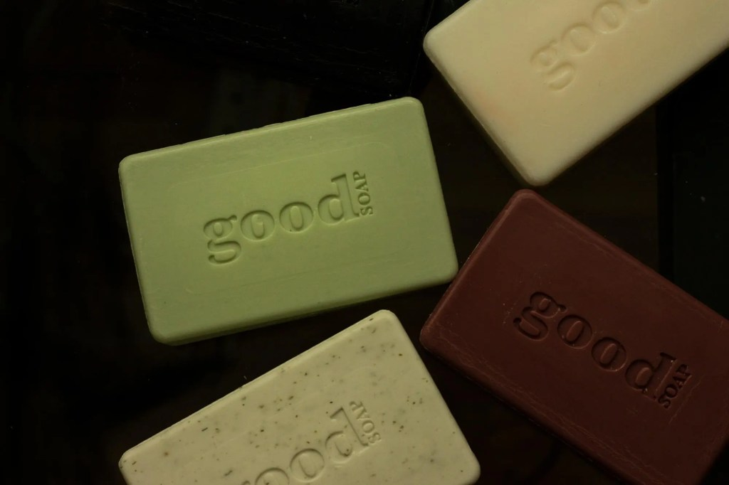 different colored bars of Good Soap by Alaffia on a black background