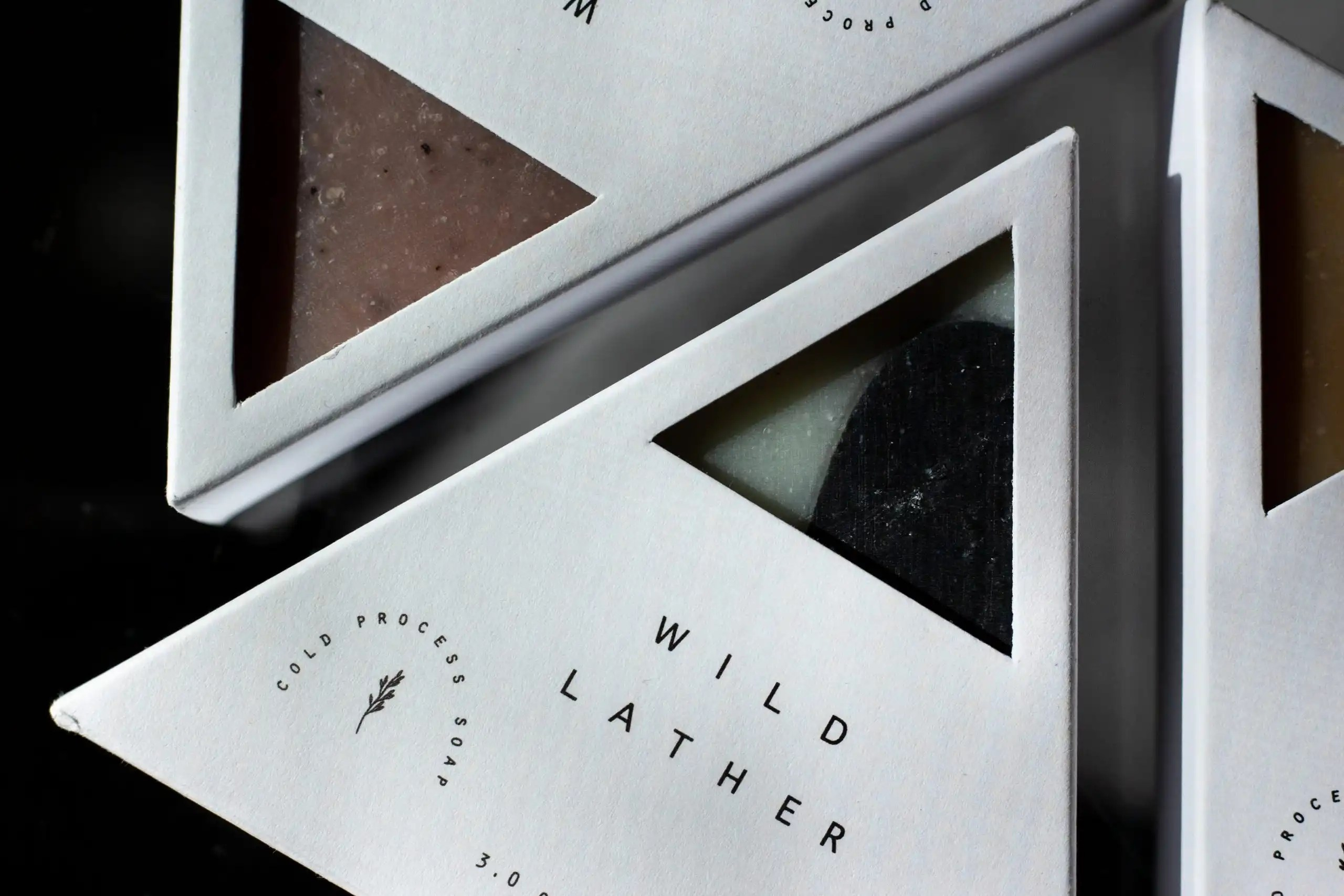 Wild Lather triangular soap in white packaging on black background