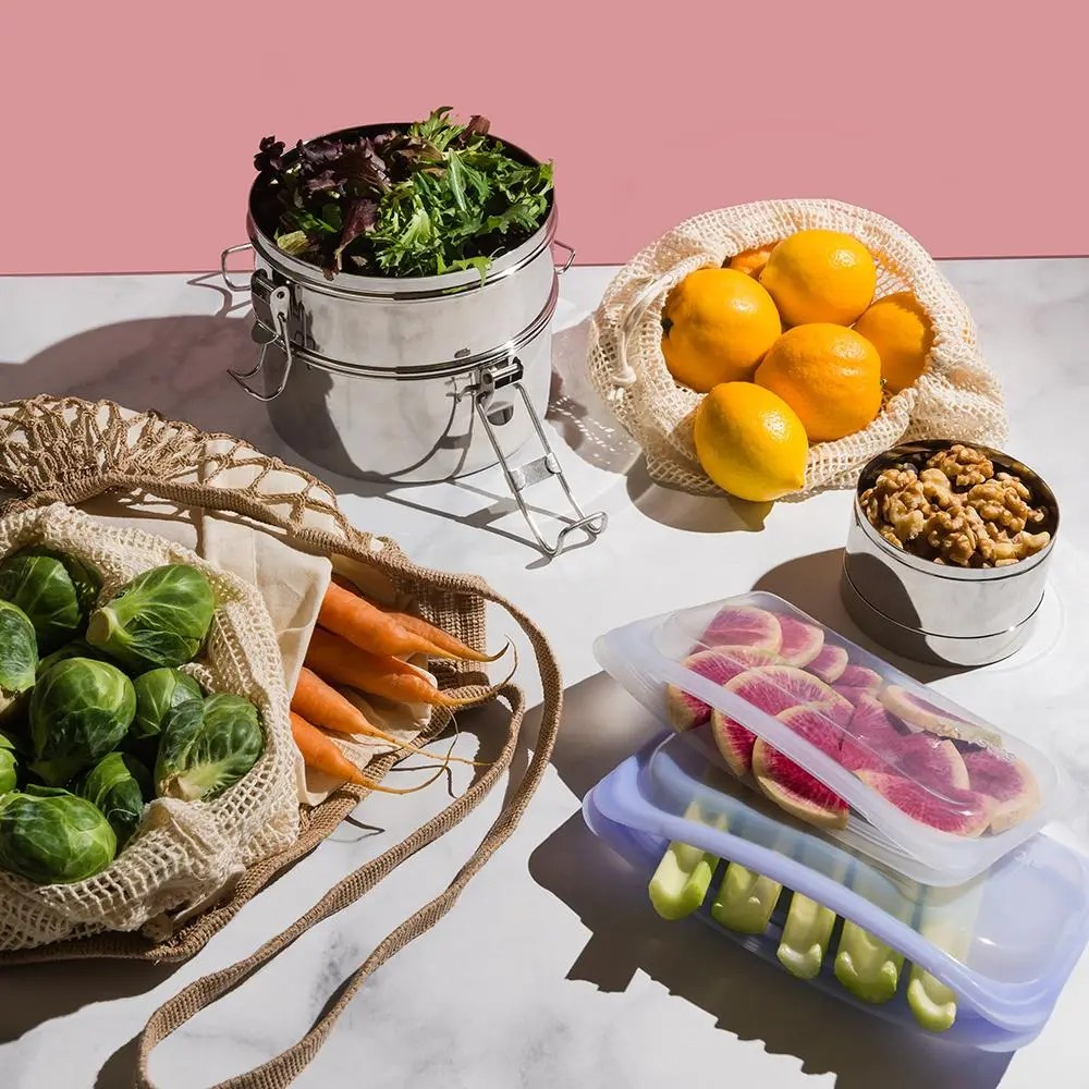 zero waste objects on a table filled with different foods