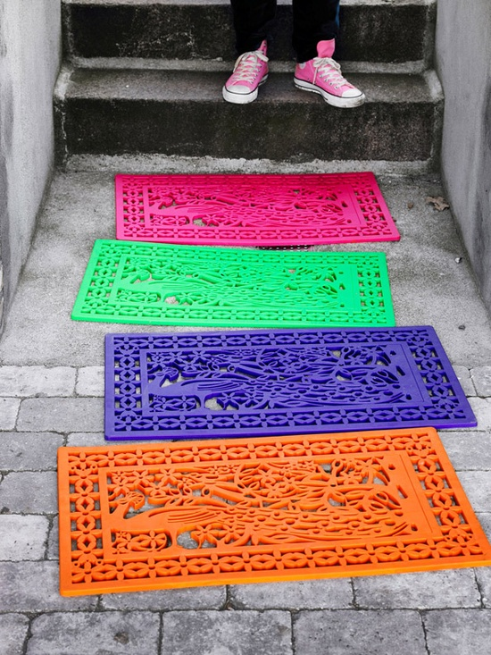 welcome your guests with plain door mats sprayed in festive colors