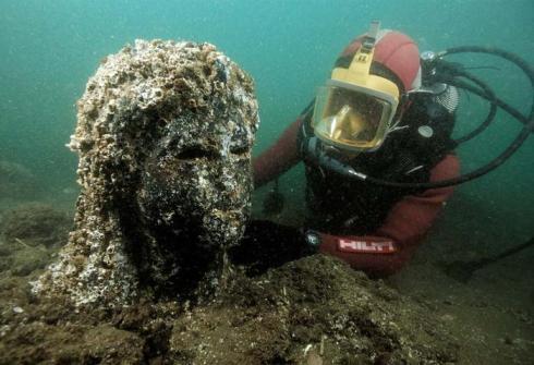 underwater ancient statue