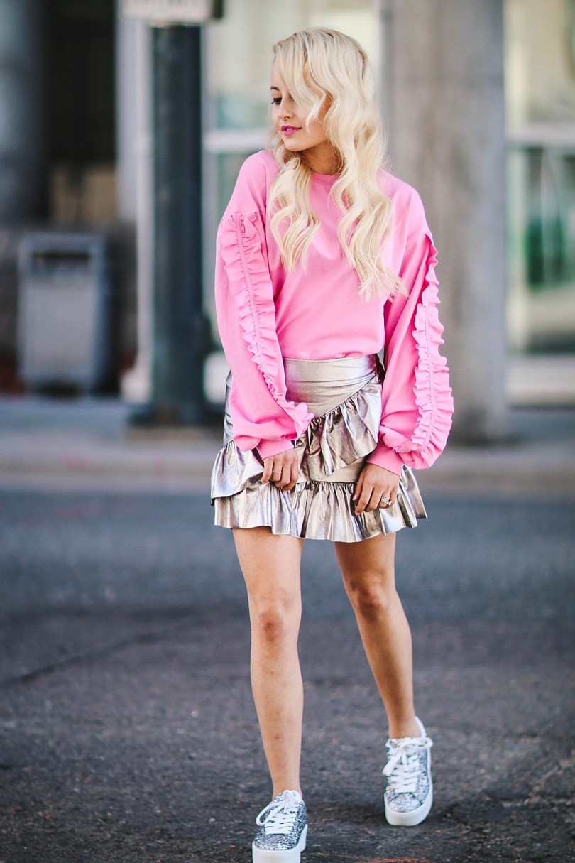 Alena Gidenko of modaprints.com styles a pink ruffle sweater with a silver ruffled skirt