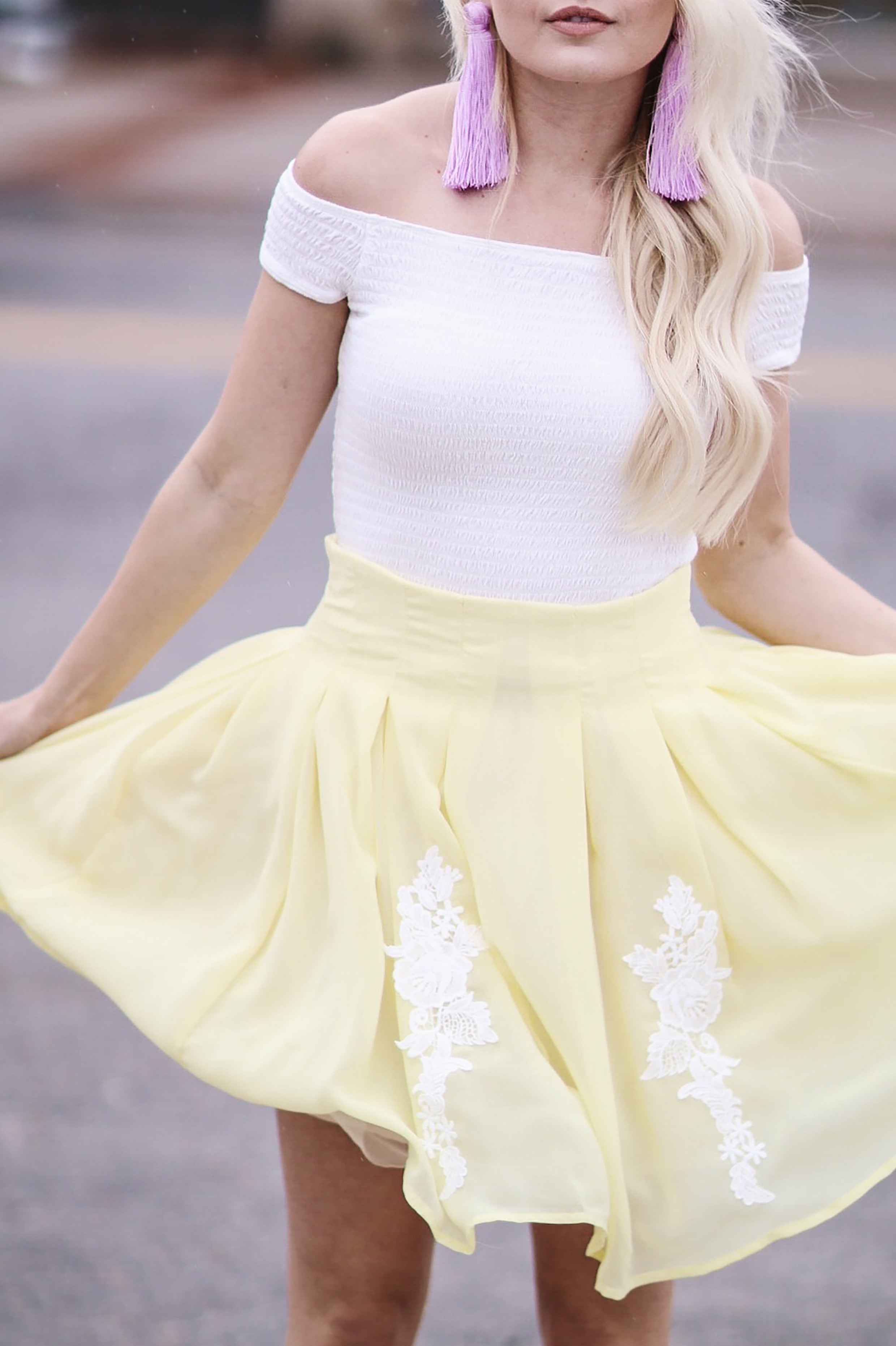 Alena Gidenko from modaprints.com styles a yellow lace skirt with an off shoulder white top for Spring and Summer
