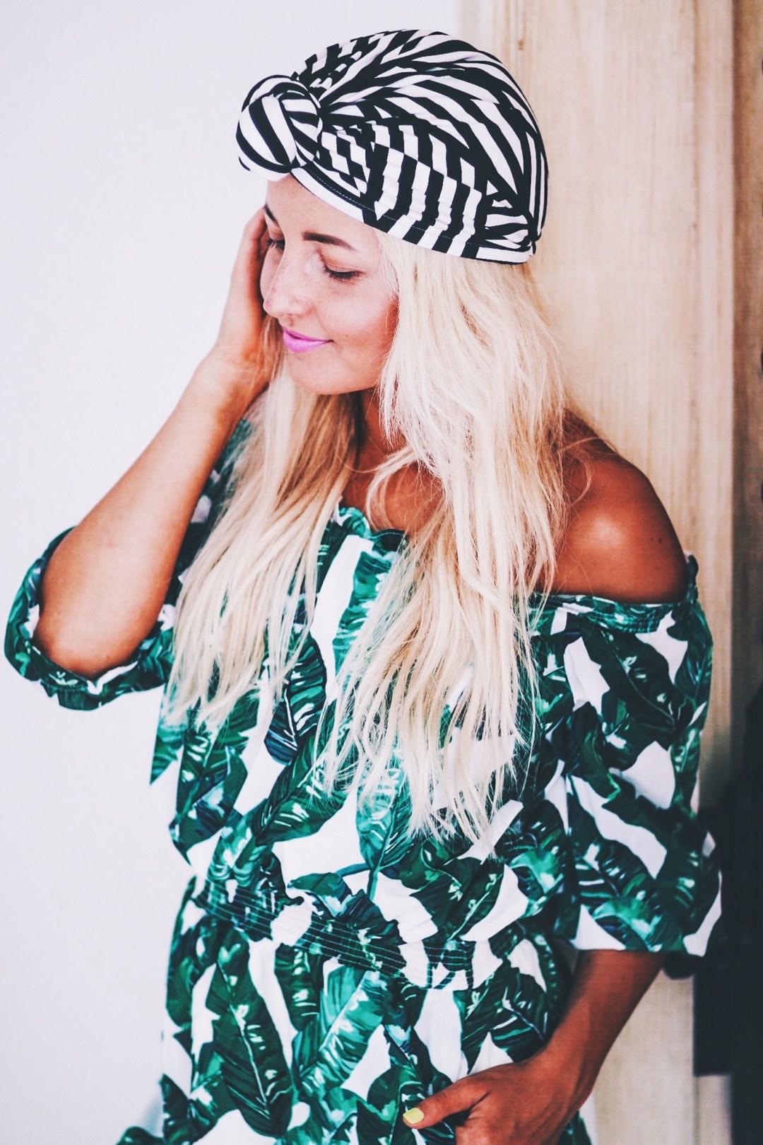 Alena Gidenko of modaprints.com styles a palm print romper for the beach