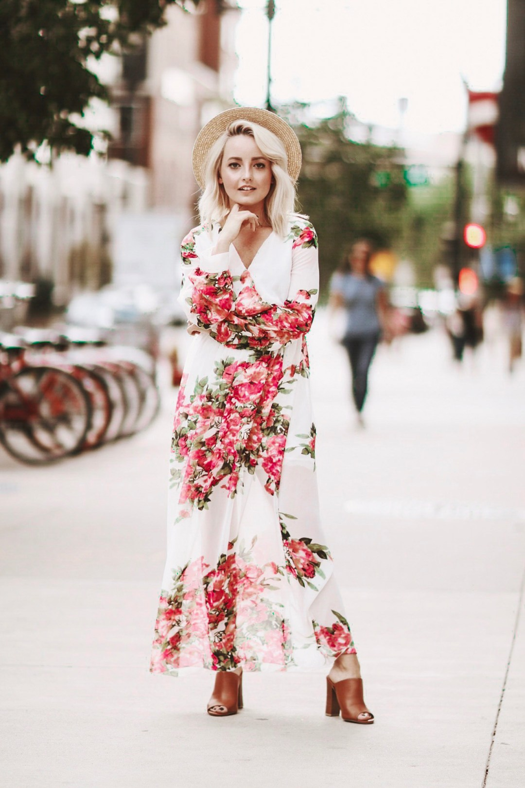 Alena Gidenko of modaprints.com styles a floral maxi dress for Fall with brown open toe mules