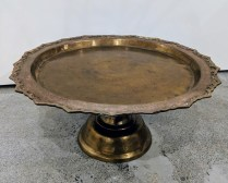 "Vintage brass footed tray, probably from India. 17""d. x 8""h. 85.-"