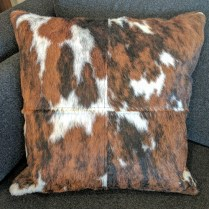 "**ITEM NOW SOLD**Cow hide and leather pillow. Down and feather insert. 19"" square.150.-"