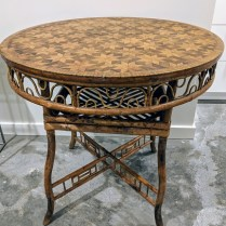"""**ITEM NOW SOLD** Antique English table; bamboo base with parquet inlay top. From the Jane Piper Reid Collection. 32.""""d x 30""""h. Orig. List: $4,930. Modele's Price: 950.-"""