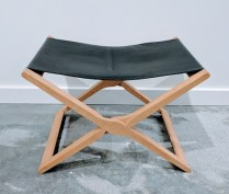 **ITEM NOW SOLD**Folding leather stool. Purchased at Egberts 12 years ago. Soap treated white oak with vegeta leather. Made in Denmark.Original list: $695.-Modele's price: 295.-