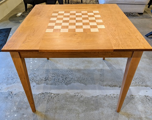"""McKinnon game table. Solid cherry with maple inlay. Showroom sample, not used in a home. 36"""" sq. x. 30""""h. Orig. List: $1,599. Modele's Price: 750.-"""