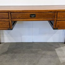 "**ITEM NOW SOLD** Campaign-style writing desk, oak. Approx. 15 years old. Very nice flush drawer pulls and antiqued brass corners. Finished on back, can be floated in a room. 56.5""w x 21.25""d x 30.75""h. 350..-"