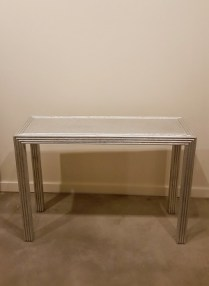 Silver Leafed Console Table. Original Price: $2000. Modele's Price: 650.-