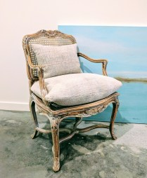 **ITEM NOW SOLD** Vintage caned chair. Includes custom cushions made from French Linen. 295.-