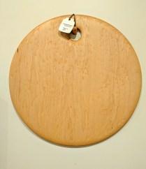 "Edward S. Wohl cutting board. 20"" round 210.-"