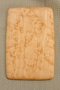"Birds-eye maple cheese/ bread board 5.5"" x 8"". 30.00"