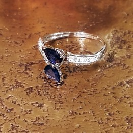 14k white gold crossover ring with 2 pearcut sapphires and 1 CTW diamonds. $595.-