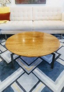 **ITEM NOW SOLD** Round Walnut Veneer Coffee Table. Steel base. Original List: $1200.- Modele's price: 325.-